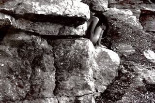 Woman in the Rocks